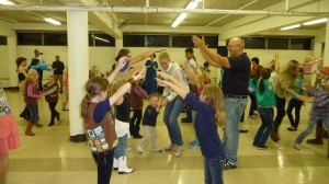 Dance down through the arches at a Girl Scout dance